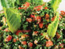 TaboulehThis fresh, tangy salad is a healthy iftar option. Use the lettuce leaves in place of spoons to scoop the tabbouleh from the bowl.Ingredients• 3 bunches of flat leaf parsley• 75g mint leaves• 4 spring onions• 1 buffalo tomato• 3/4 cup bulgar wheat• 2 lemons, juiced• 1/3 cup olive oil• 1/2 tsp cumin• Romaine lettuce leaves• Salt and pepper to seasonMethod• Soak the bulgar in cold water for around 90 minutes, then squeeze out all excess water and set aside.• Wash the parsley, remove the stalks and chop finely.• Remove stalks from the mint leaves, then chop finely.• Put the tomato in a jug of boiling water for a few minutes, then peel off the skin, which should come away easily. Chop into small chunks and discard the seeds.• Wash and dice spring onions.• Combine all ingredients in a mixing bowl. Add the cumin, the juice of the lemons and salt and pepper to taste.• Line a serving bowl with large romaine lettuce leaves that overhang the edge slightly, then spoon the tabouleh on top.• Stick a few extra lettuce leaves into the middle of the mixture if there's not enough for each diner around the sides of the bowl.Top tipThis tabouleh recipe uses spring onions, but red, brown or white onions are also fine